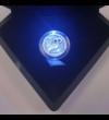 Cutie exclusivă cu LED, care luminează moneda la deschiderea cutiei