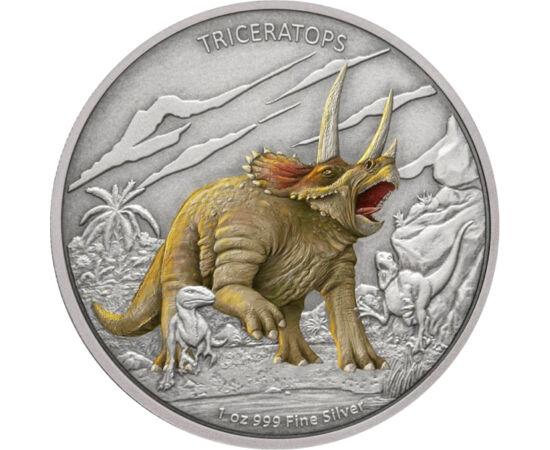 """// 2 dolari, argint de 999/1000, Niue, 2020 // - Un alt dinozaur din perioada cretacică este triceratopsul, """"faţa cu trei coarne"""". A fost un animal care a trăit în turme mari, a avut 3 m înălţime, 9 m lungime şi o greutate de 6 tone. Moneda pictată o livr"""