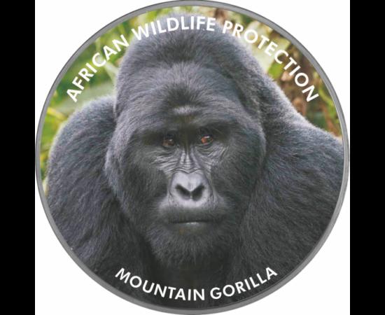 """// 2000 şilingi, pictat, placat cu argint, Uganda, 2006 // - Pe această monedă pictată apare gorila de munte, animalul din Africa ameninţat cu dispariţie. Inscripţia monedei """"Protecţia faunei africane"""" ne atrage atenţia asupra acestei specii pe cale de di"""