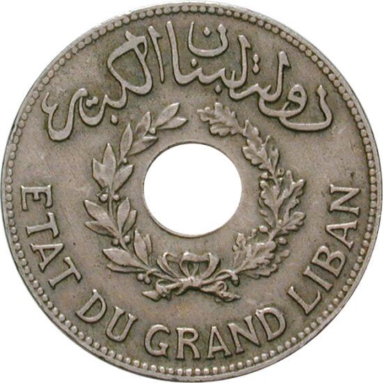 // 1 piastru, Liban, 1925-1936 // - Liban şi-a obţinut independenţa faţă de Franţa în 1946. De atunci însă, ţara este sfârtecată de războaie. Această monedă interesantă a fost emisă de peste 70 de ani. Practic, o fac interesantă gaura din mijloc şi inscri
